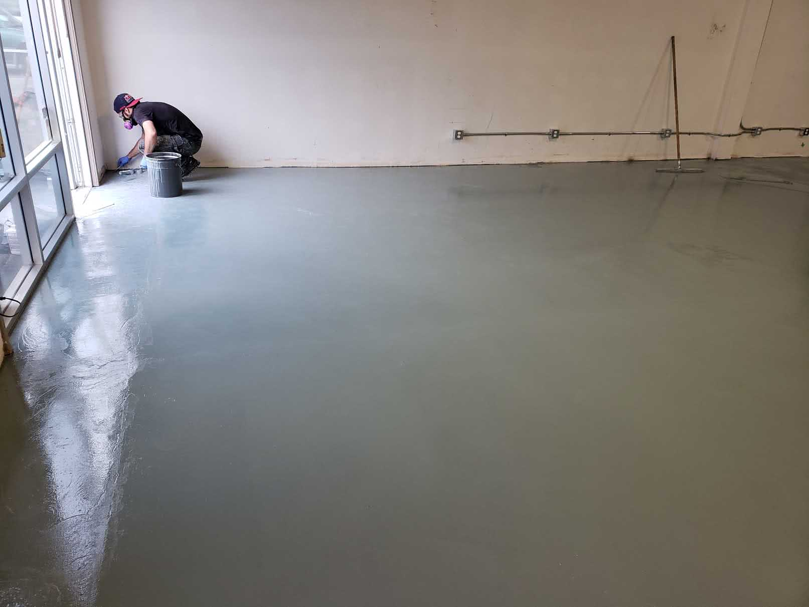Concrete resurfacing and epoxy floor coating at Jusu Body